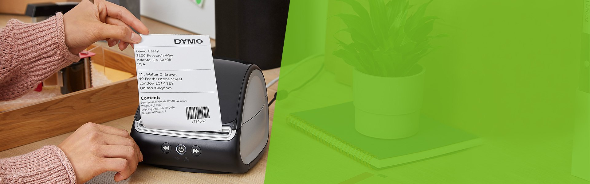A person tearing a large shipping label from a Label Writer label printer.