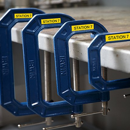 Four clamps of different sizes with yellow labels that read Station 7.