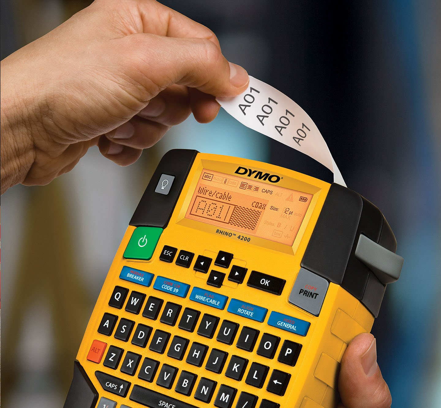 A closeup of a Rhino 4200 industrial label maker printing labels.