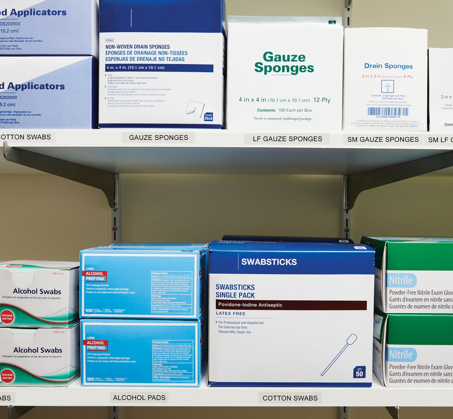 Labeled shelves of medical supplies.