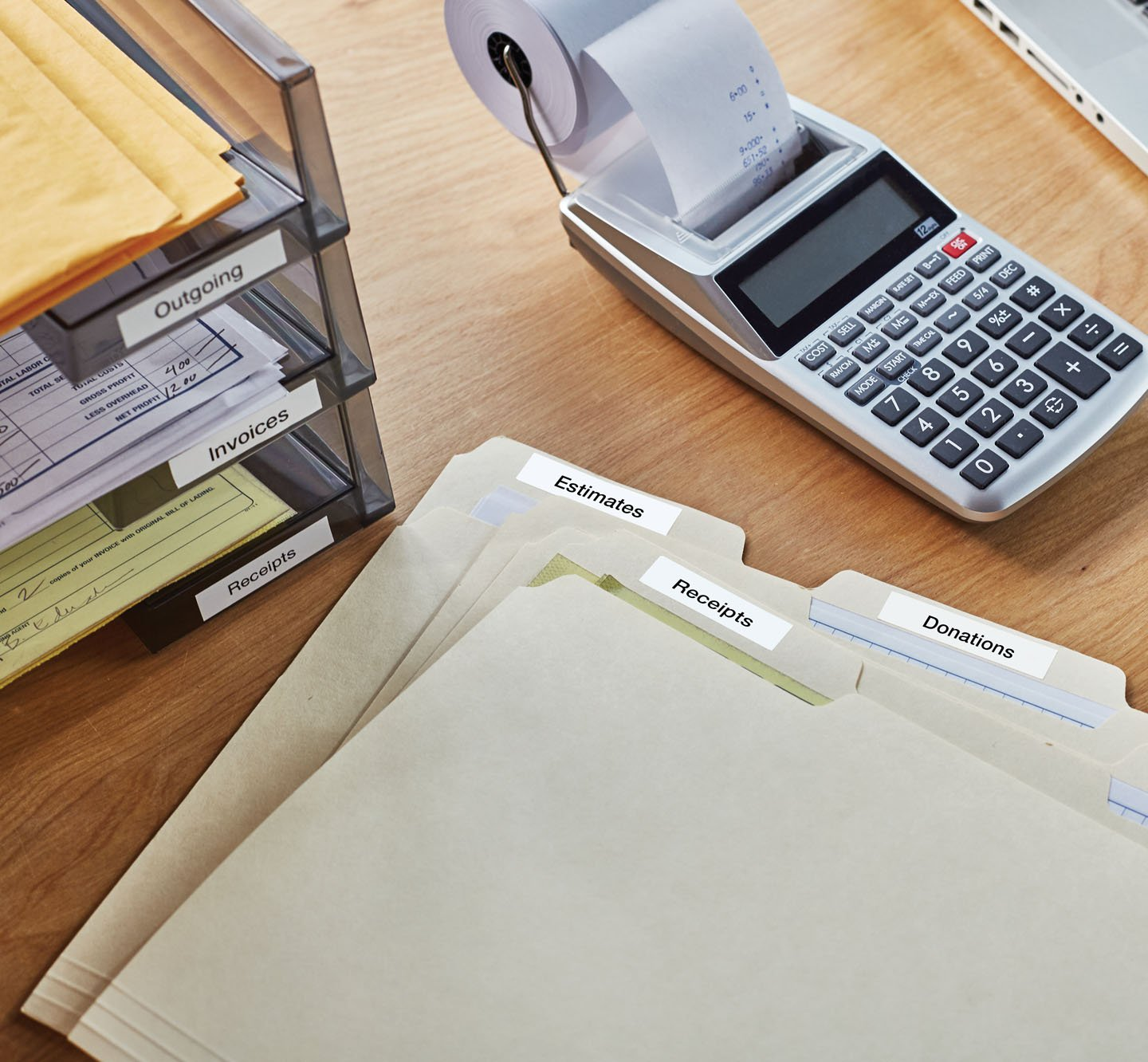 Labeled files and a labeled file organizer on a desk.