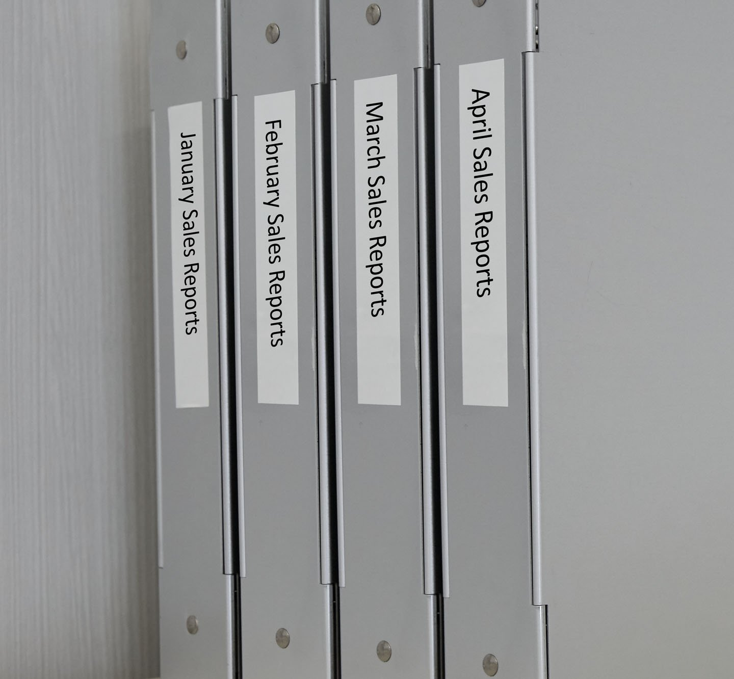 Row of labeled binders.