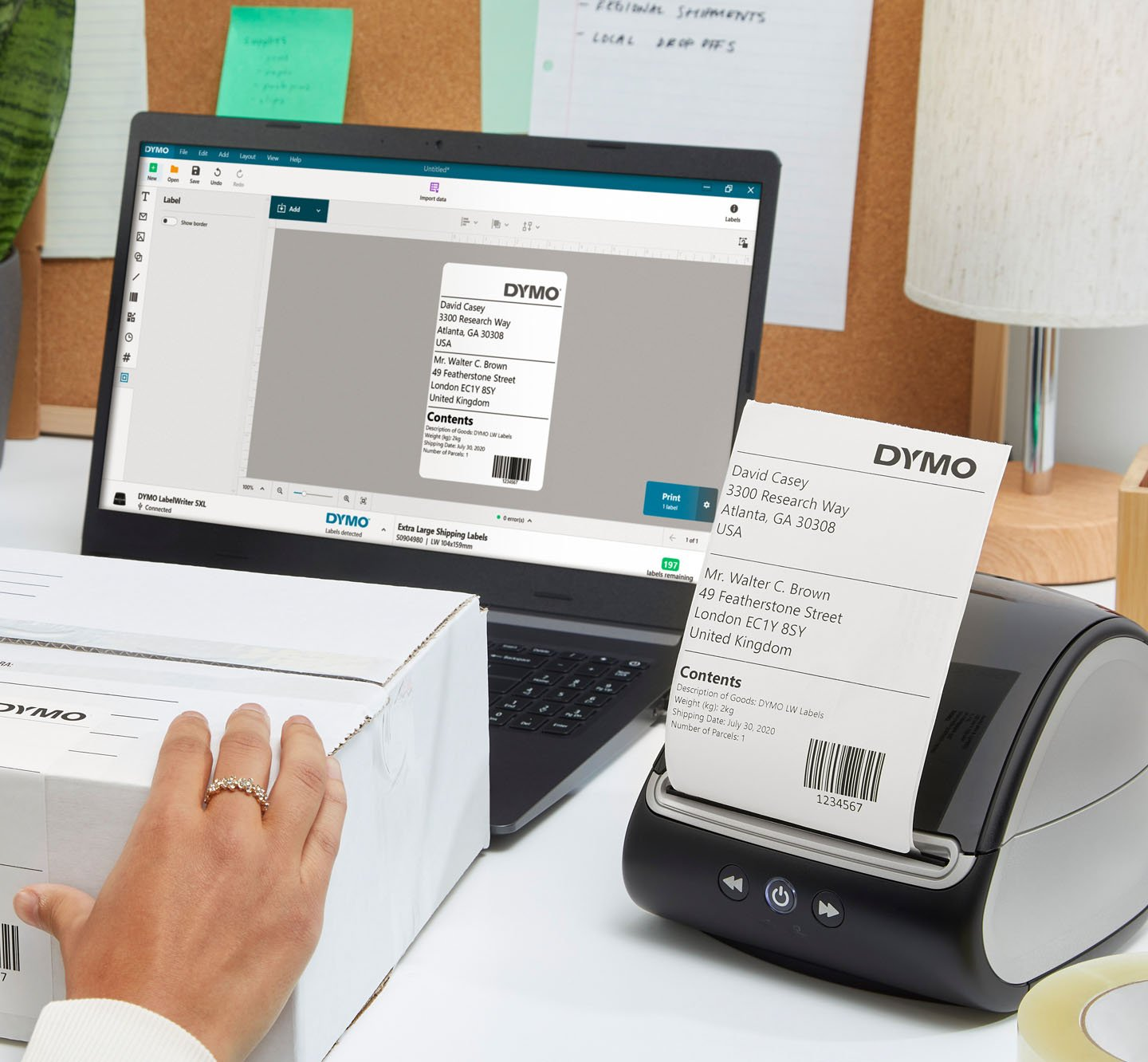 A label printer connected to a laptop computer printing a shipping label.