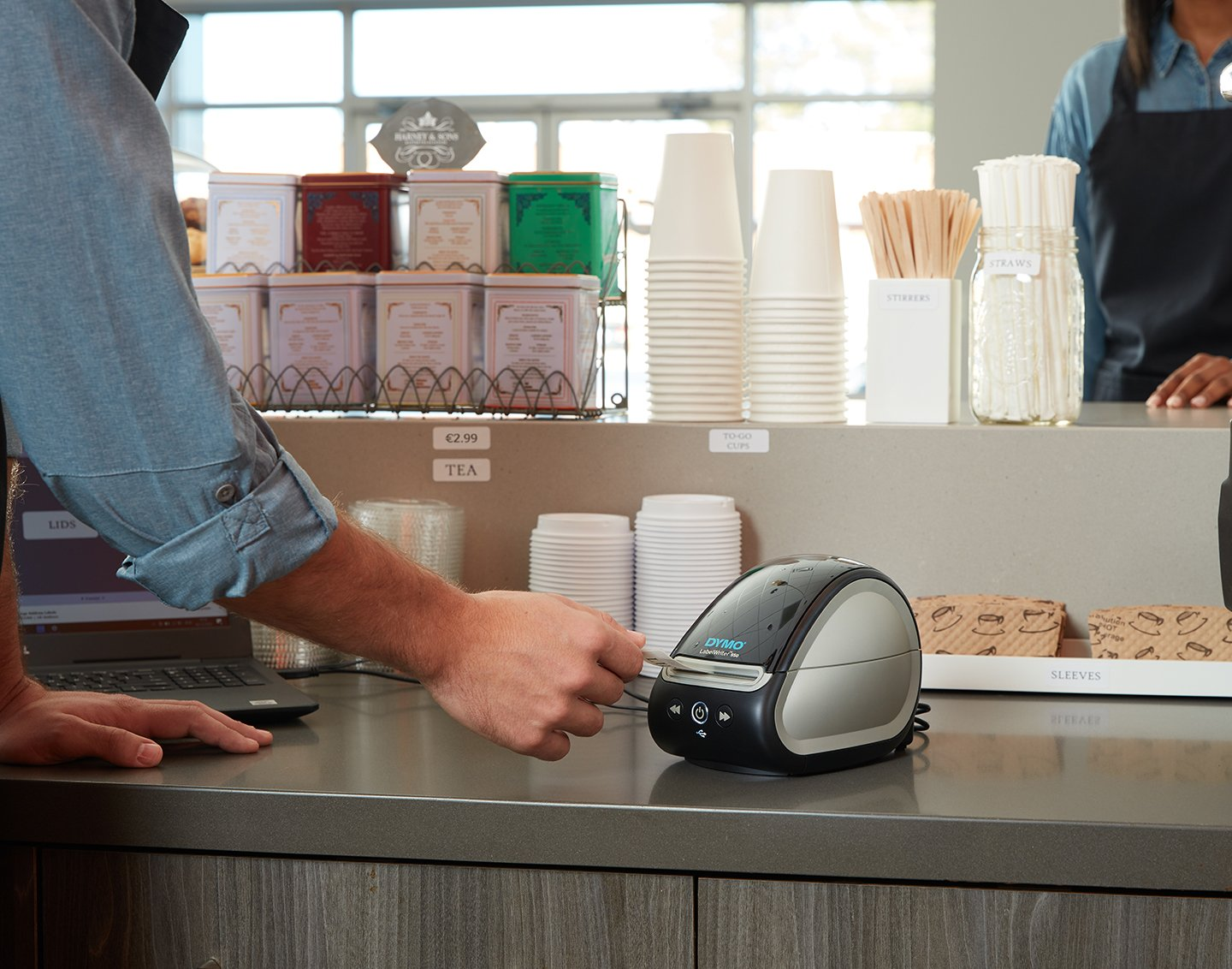 A label writer printing a label on a countertop.