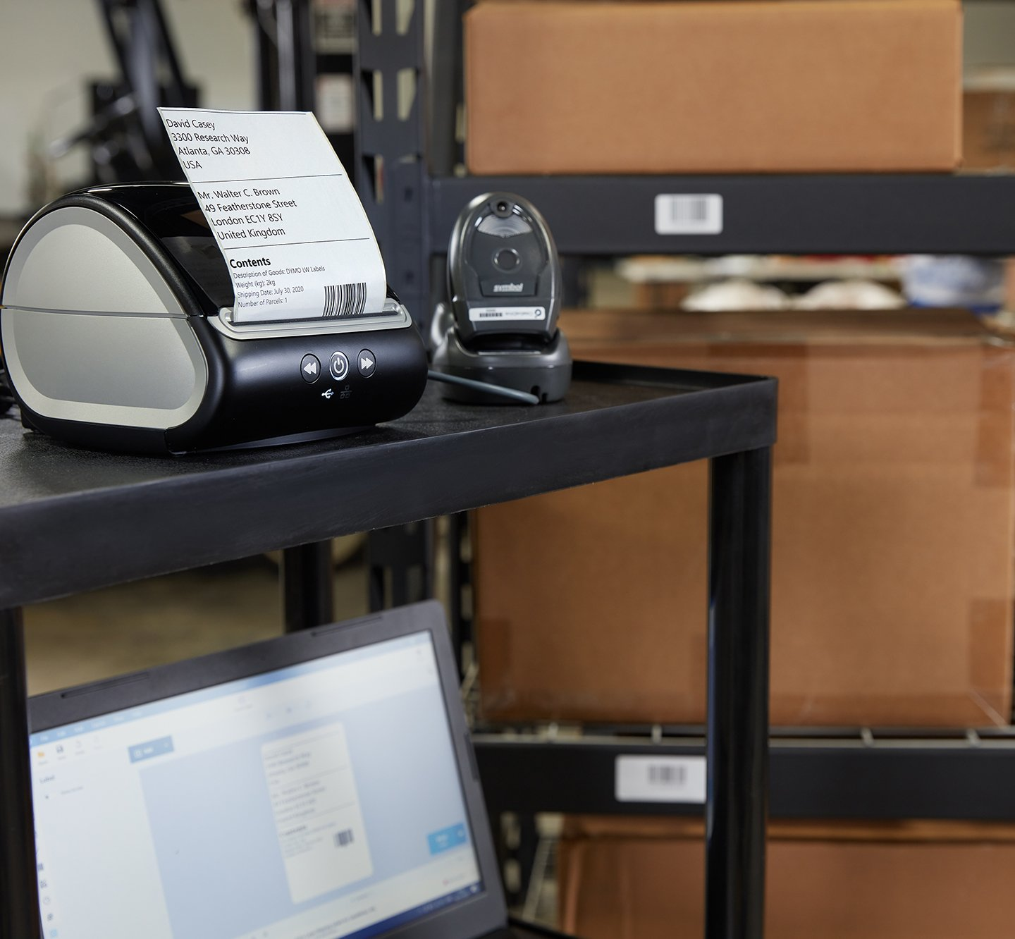 A Label Writer 5 X L printing a shipping label.