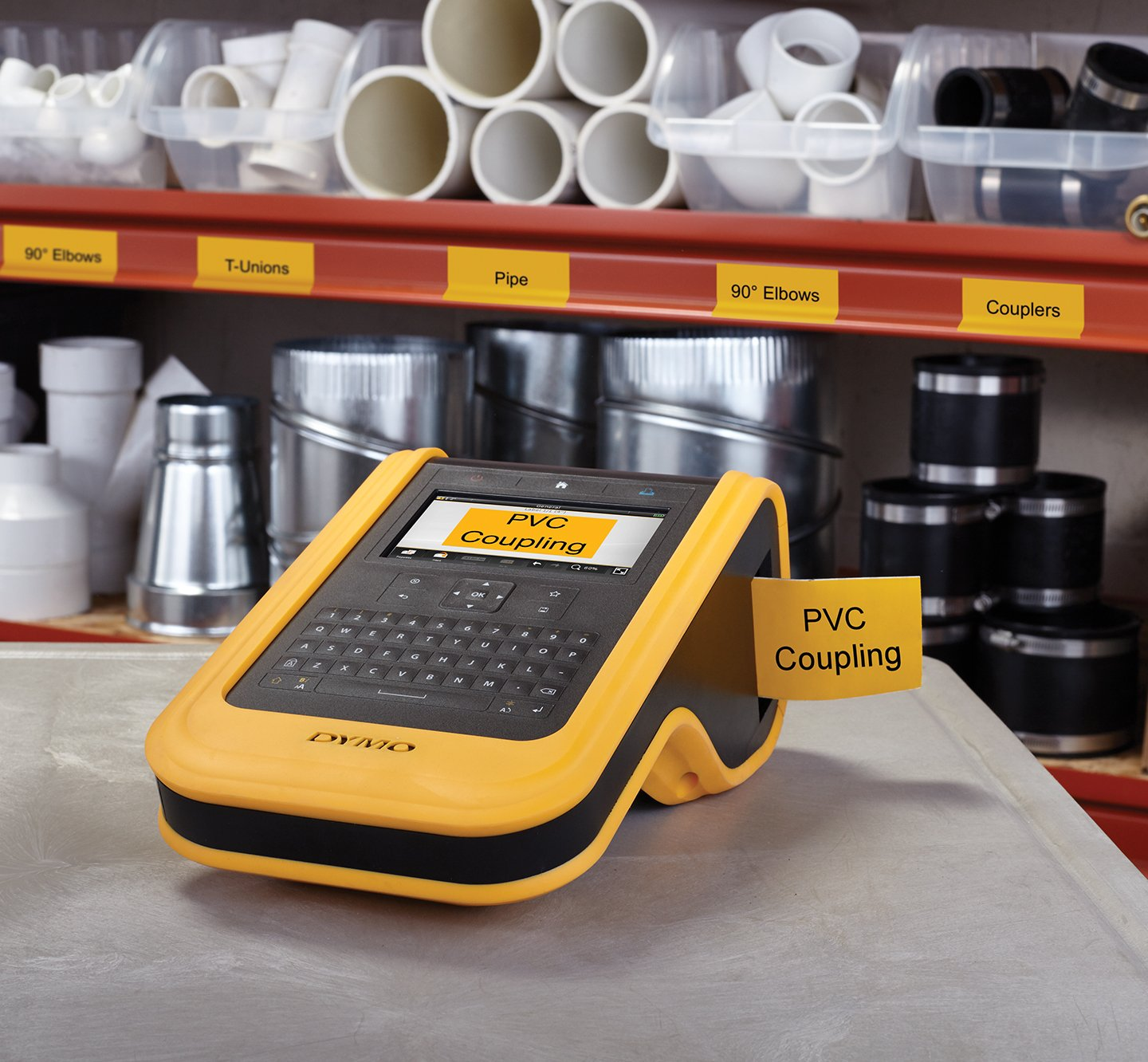 X T L label maker printing a yellow label for P V C Coupling.