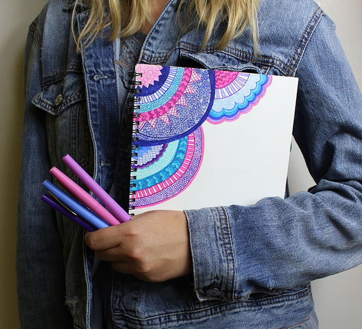 hand doodled notebook cover with flair pens