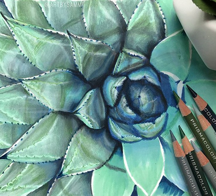 Colored pencils next to floral drawing