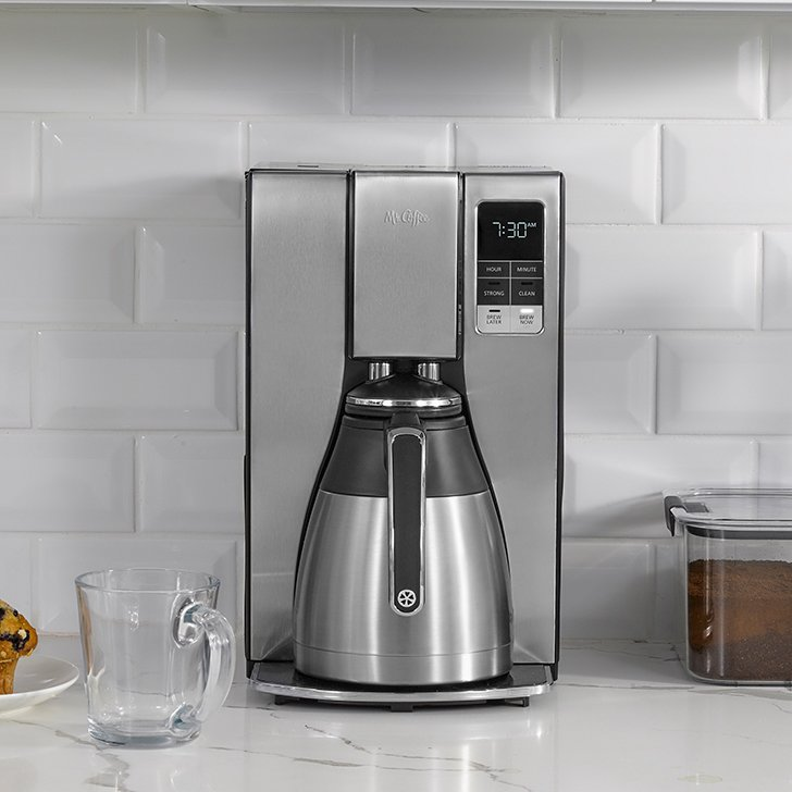 silver coffee maker with thermal carafe on counter