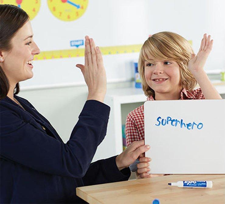 teacherhighfivingstudentinclassroomtile.jpg