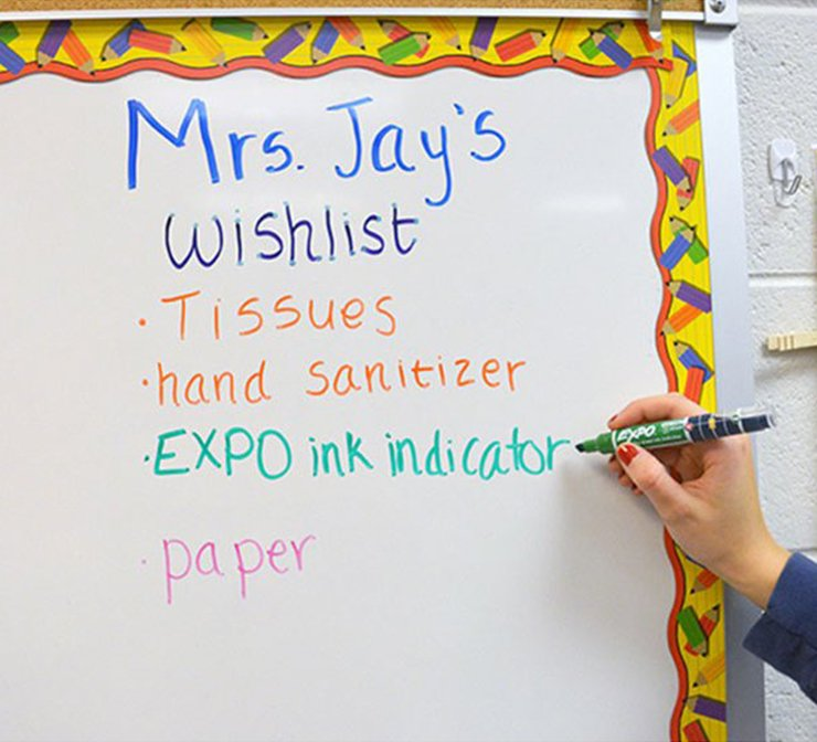 teacherwritingondecoratedboardwithgreeninkindicatormarkertile.jpg