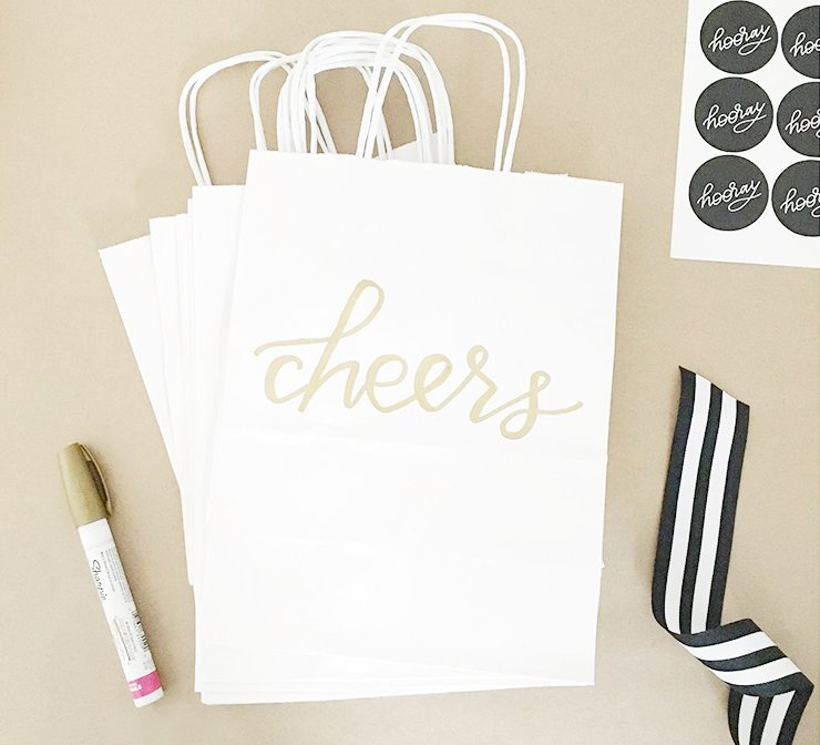 Gold paint pen and decorated gift bags