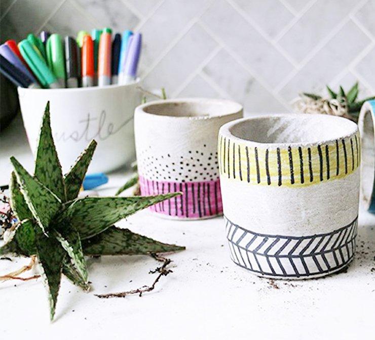 whiteplantersdecoratedwithcolorfulsharpiedecorationstile.jpg