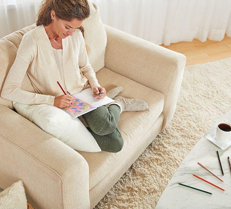 womancoloringincomfychairusingprismacolorcoloredpencilstile.jpg