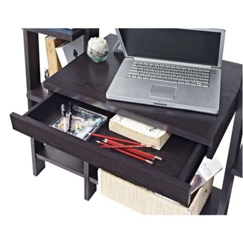 Top of writing desk shown with pencil drawer open
