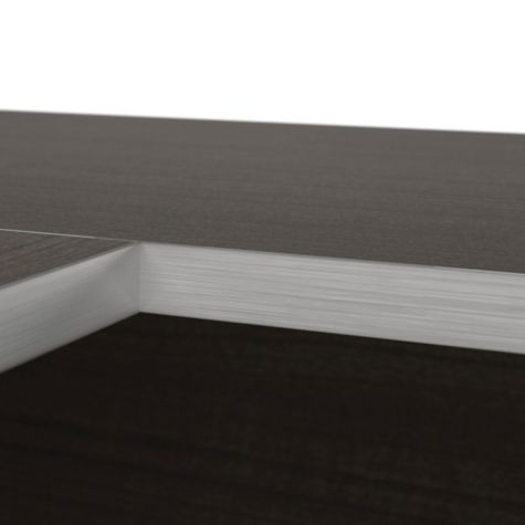 Close up of dark chocolate silver desk edging