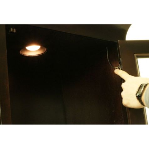 Touch operated light in hutch