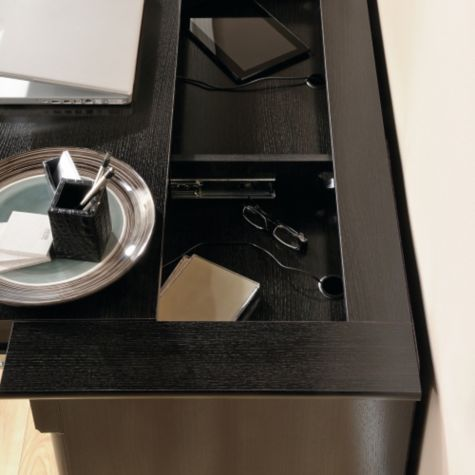Worksurface pulls out to reveal hidden storage