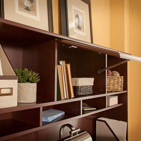 Flip-top center storage space