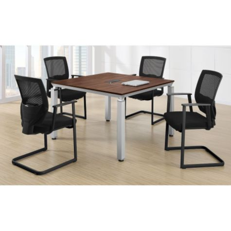 Four chairs comfortably sit around table.