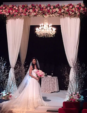 White-Knit-Chuppah-with-Venetian-Chandelier-and-Floral-Accent-Header