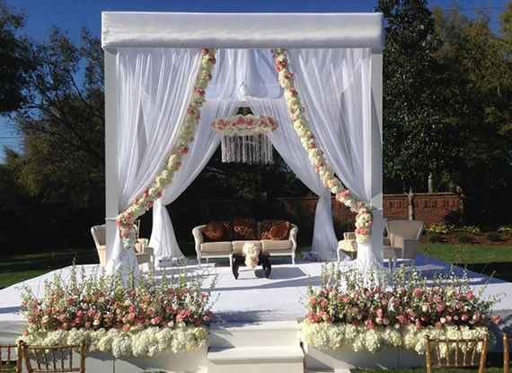 White-Sheer-Ceremony-Structure-on-White-Covered-Stage-with-Floral-Accents