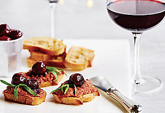 Duck rillette bites with candied cherries