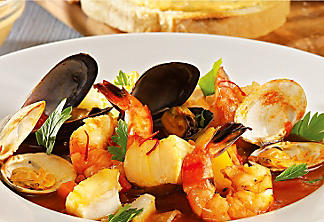 Bouillabaisse and rouille sauce with basil