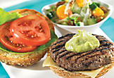 Grilled burger with homemade mayonnaise and fresh salad