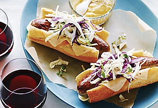 Duck hot dog with cabbage and tapenade