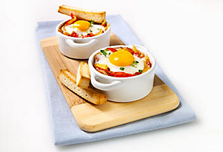 Basque-style egg casserole with baguette sticks