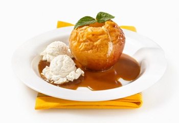 Baked apples with vanilla ice cream and cider coulis