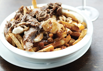 Shredded duck poutine from chez victor