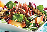 Duck confit salad with mushrooms and plum dressing