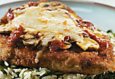 Veal cutlet parmigiana with mushrooms