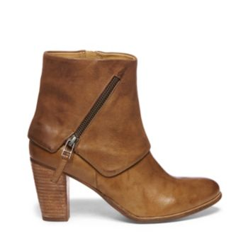 CAITLIN is a revamped version of the classic bootie style. Constructed of leather, CAITLIN sports a stacked heel, a zipper on one side, and the quirky slanted zipper along the other. Be sure the pair these booties with a patterned skirt, plain top, and cropped jacket for a stylish on-the-go outfit. Leather upper material PU lining Manmade sole
