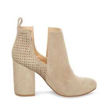 Meet NOMAD, our latest take on a timeless bootie! With trendy dipped sides, this compact classic takes on one of this season's hottest silhouettes, while a chic lattice-cut back panel lends the style fresh texture. Suede upper material Man-made lining Man-made sole 3.75 inch heel height 9 inch shaft circumference 3 inch shaft height Deep side cutouts Chunky block heel Almond toe