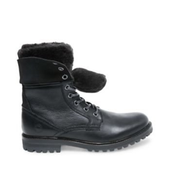 Do cold weather right in OLYMPUS - a boot designed to keep your feet warm while tackling any terrain. The style\\\'s lug sole promises slip-proof stepping, while its leather upper features faux fur lining for a cushioned feel and added insulation. Leather upper material Textile lining Rubber sole 1.25 inch heel height 7.25 inch shaft height