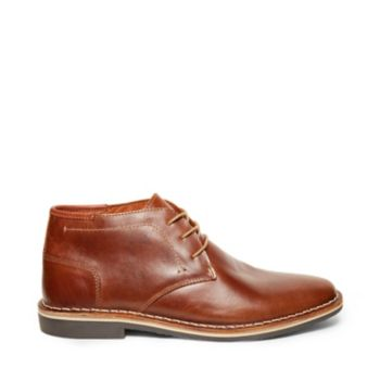 The HARKEN chukka is the kind of lace-up style that will become your go-to. The rich leather upper has just the right amount of rustic charm that makes these beauties perfect with anything from jeans to khakis. Leather upper material Textile lining Man-made sole 1 inch heel height