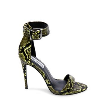 It's no wonder that stylin' sirens are lining up for ANGELA this season, as serpent-inspired surfaces give this sexy stilettoed silhouette an exotic element that's hard to resist! Pair the sandal with a slinky dress for an ultra-seductive look, or don it to dress-up your skinny jeans. Printed PU upper material Man-made lining Man-made sole 4.25 inch heel height