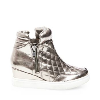 Futuristic and luxe, this sneaker-soled bootie features a hidden wedge and quilted metallic uppers. Dual side zipper closures offer convenience and a modern look. Man-made upper material Fabric lining Rubber sole with leather Functional outside zipper Decorative inside zipper 1 inch platform 2 inch wedge