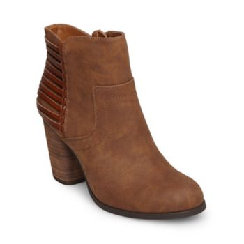 A new must-have for bohemian babes, DUSK is a cute little bootie with a round toe, sturdy heel and cool caged back detailing. Pair this versatile new style with garb ranging from denim separates to prairie dresses! Leather upper material Man-made lining Rubber sole 4 inch shaft circumference 3 inch heel height Inside functional zipper Madden Girl