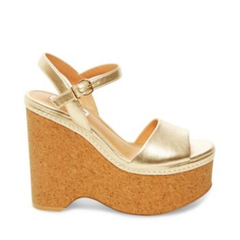 With a cool cork platform wedge sole and classic leather upper, SHAYNE makes it easy to channel your inner 1970s babe! Rock this retro-rustic sandal with a pair of bell-bottoms or wide-leg jeans. Leather upper material Man-made lining Man-made sole 4.75 inch heel height 1.5 inch platform