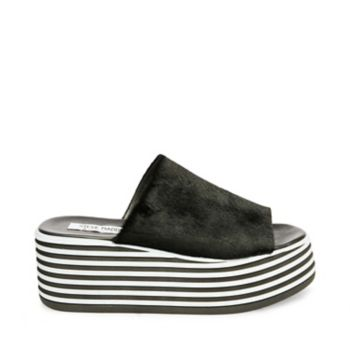 With a stylishly striped, extra-tall platform sole, the SHOT slide will lift you up while elevating your ensemble! An elongated upper gives the sandal a foot-hugging fit, ensuring a steady stride. Made in the USA Leather or pony hair upper material Leather lining and sock Rubber outsole 2.75 inch heel height 1.5 inch platform