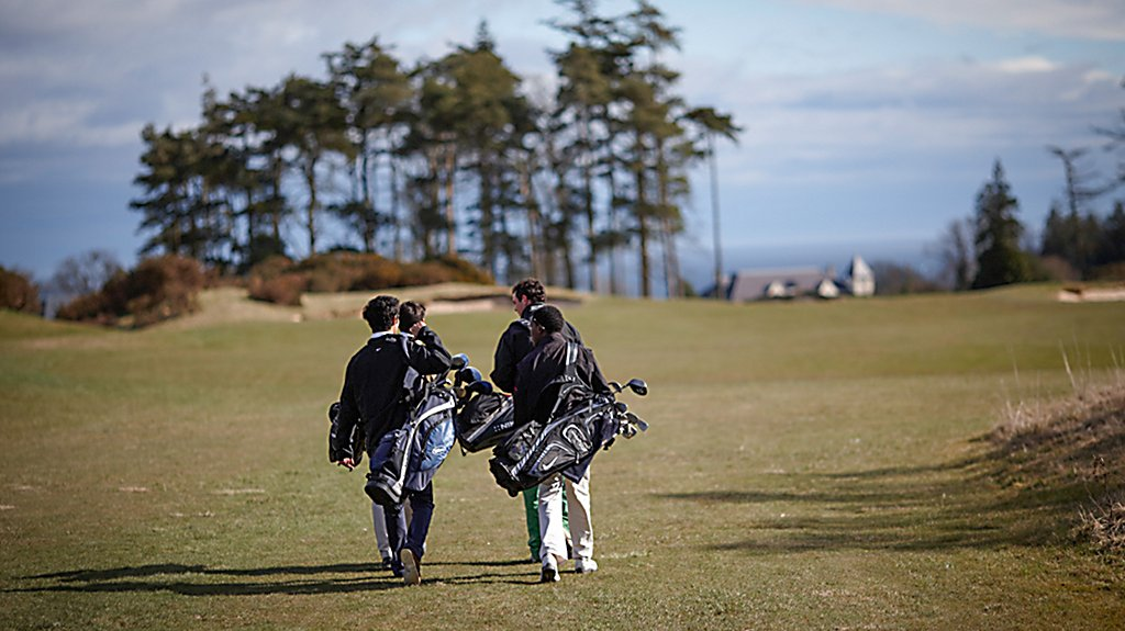 Golfers walking the fairway