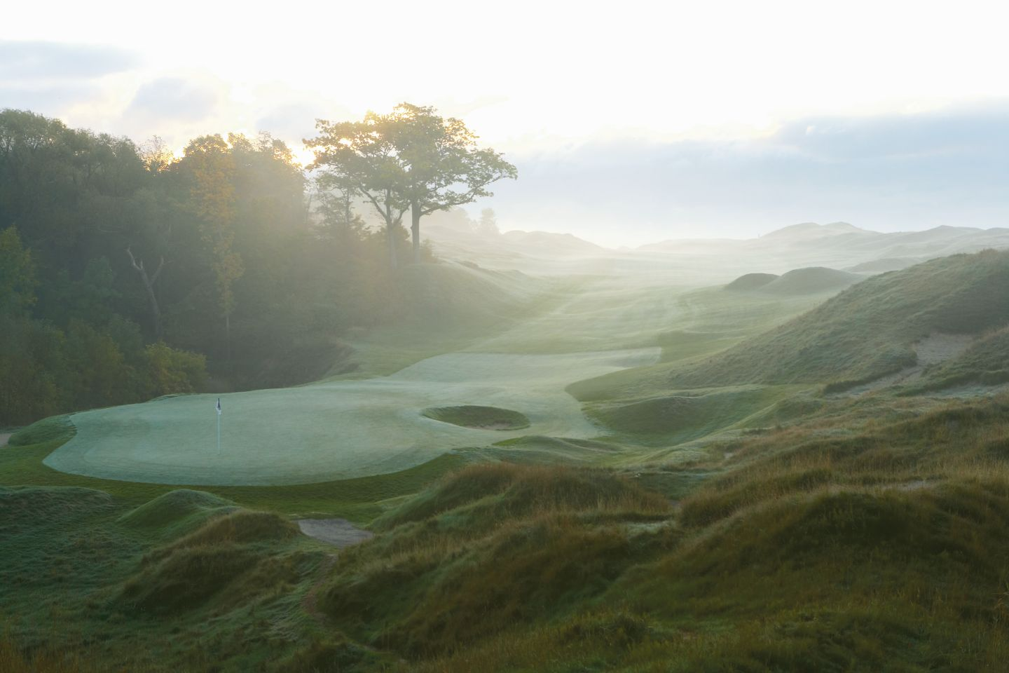 The green of the ninth hole on the Straits Course at Whistling Straits with fog.