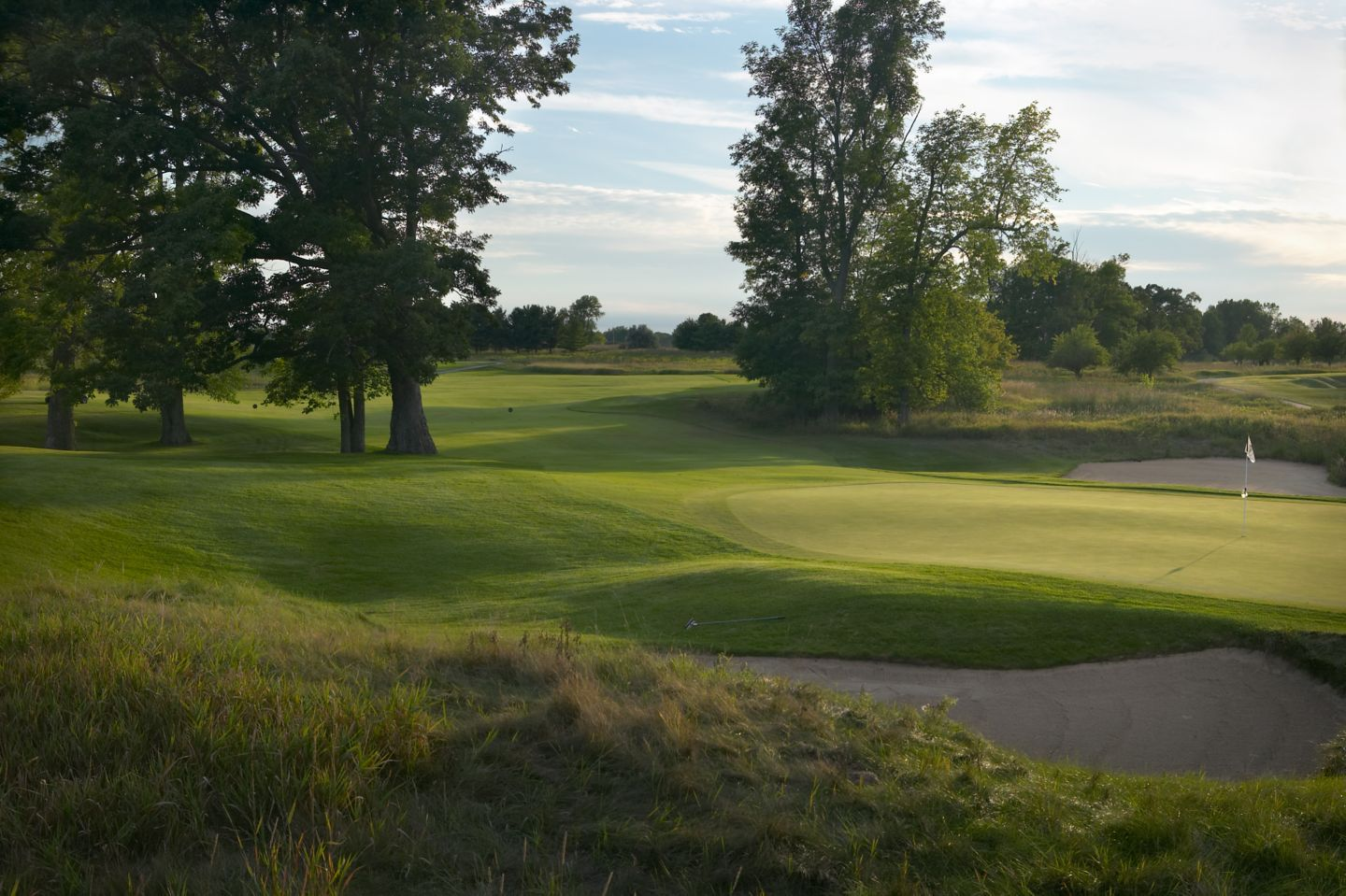 Hole 5 of the Meadow Valleys course with two large tree strands on each side of the fairway.