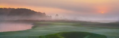 Hole 7 of the Meadow Valleys at sunrise with fog and haze.