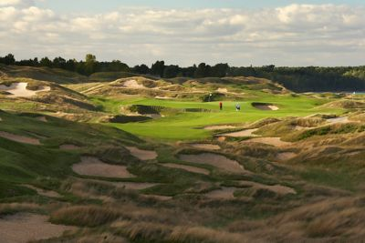 The bunkers with golfers on the eleveth hole of the Straits Course at Whistling Straits.