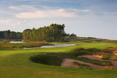 A view of the par 5 hole named the Snake from the fairway to the green.